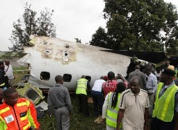 The charter plane suffered engine failure shortly after takeoff from Lagos. It crash-landed near an airport fuel depot. (AP Photo/Sunday Alamba)