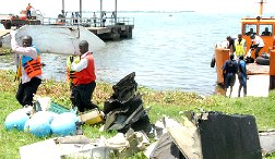TRAGIC: Rescue workers gather debris from the wreckage. PHOTO BY STEPHEN WANDERA W'OUMA