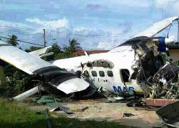 The smashed-up front portion of the plane outside the house // www.thestar.com