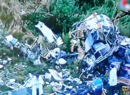 The wreckage of the crashed helicopter