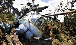 The wreckage of the crashed Ugandan Mi-24 attack helicopter