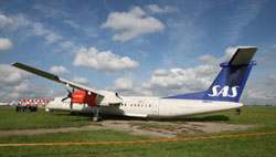 A Scandinavian Airlines, SAS, plane seen off the runway at the airport in Vilnius, Lithuania, Wednesday, Sept. 12, 2007.
