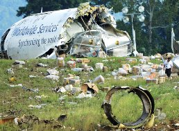 Debris of a UPS A-300 cargo plane on a hill at Birmingham-Shuttlesworth International Airport after crashing on approach// AP photo/ AL.com, Mark Almond