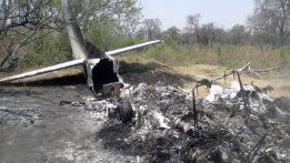 The wreck of a crashed plane lays in the bush in the Okavango Delta. The light aircraft carrying 12 people crashed shortly after takeoff killing the British pilot and seven tourists from France, Switzerland and Britain.