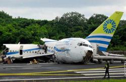 1.The wreckage of a Colombian passenger jet that crashed at the airport of San Andres island is seen August 16, 2010. The Boeing 737, operated by local airline Aires, crashed while landing on San Andres island on Monday during a storm, killing one passenger and injuring 114, local authorities said. The plane carrying 121 passengers and six crew members was arriving on the Caribbean resort island when it crashed short of the runway. Photograph by: Stringer, Reuters