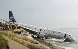 Embraer 190 skidded along the wet tarmac and slid halfway into the water on landing at Simon Bolivar Airport, Colombia.