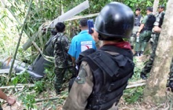 A Royal Thai Army helicopter crashed Friday while searching for Muslim separatists in the conflict-ridden deep South, killing 10 people on board.