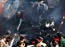 Army and police officers work at the scene of a plane crash in Sanaa, Yemen, Wednesday, Nov. 21, 2012. Yemeni security officials say a military plane has crashed during training over the capital, Sanaa, killing all 10 people on board. Photo: Hani Mohammed / AP