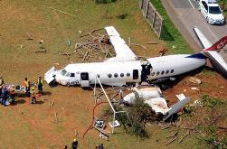 An Airlink passenger plane crashes into a school's playing fields near Durban International Airport Thursday, seriously injuring three crew members and one person on the ground.