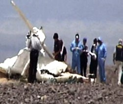 The wreckage of the crashed Cessna airplane.