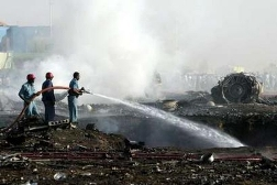 Firefighters work at the site where a cargo plane crashed near the Khartoum airport June 30, 2008. A cargo plane crashed shortly after taking off from Khartoum airport on Monday, exploding into a fireball and killing all four crew, witnesses and officials said. REUTERS/Mohamed Nureldin