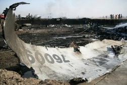 Sudanese firefighters douse the wreckage of a cargo plane after it crashed in Khartoum, killing four Russian crew members and narrowly missing residential buildings before blowing apart. (AFP/Ashraf Shazly)