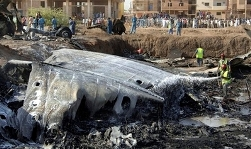 Emergency services attend the scene of a cargo plane crash which killed all four crew members in the capital Khartoum, Sudan Monday, June 30, 2008. The plane which was headed for the south Sudanese city of Juba, crashed shortly after takeoff from Khartoum's airport - the second plane crash in Sudan in a week and the third this month. (AP Photo/Abd Raouf)