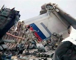 Parts of a Russian heavy-lift military cargo plane Ilyushin Il-76, that crashed on takeoff from Mirny in the Sakha Republic in Siberia are seen in this image taken from television broadcast Sunday, Nov, 1, 2009. The plane crashed on takeoff Sunday, Nov, 1, 2009, from Mirny in the Sakha Republic in Siberia, killing all 11 crew members on board, officials said. The plane hit a slag heap from an old mine and crashed, exploding on impact. The cause of Sunday's crash was not yet known. (AP Photo/Channel One)