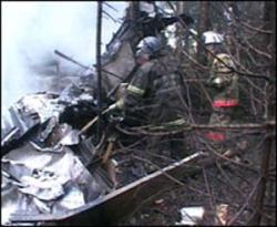 Firefighters acting at the site of the crash